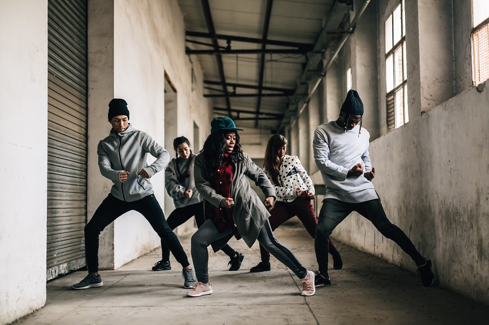 Hip Hop Team Dancing In An Old Factory.