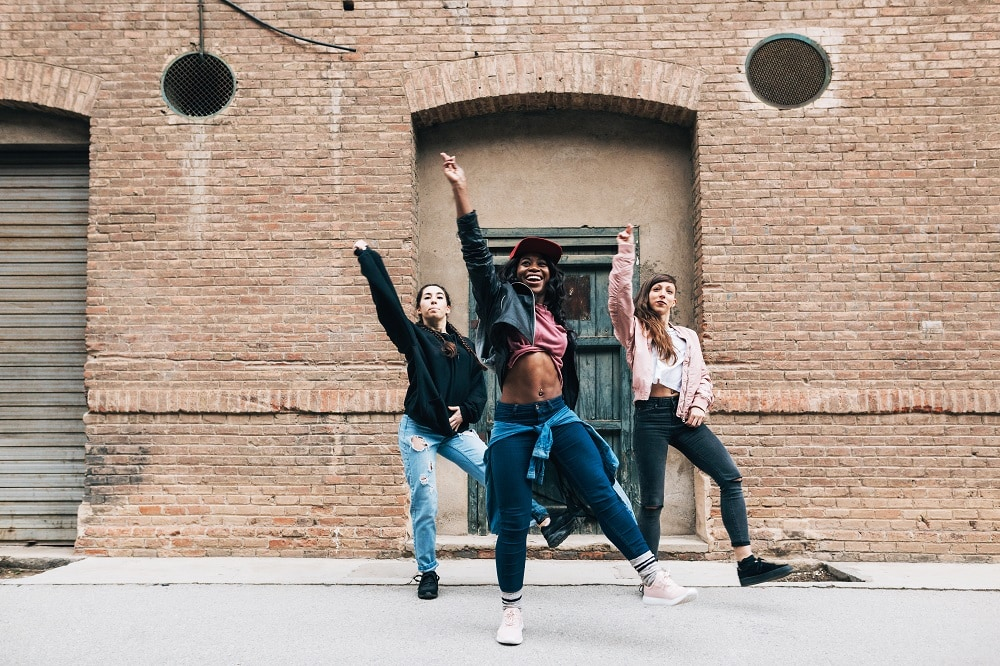 Three Female Dancing Hip Hop In The Street.
