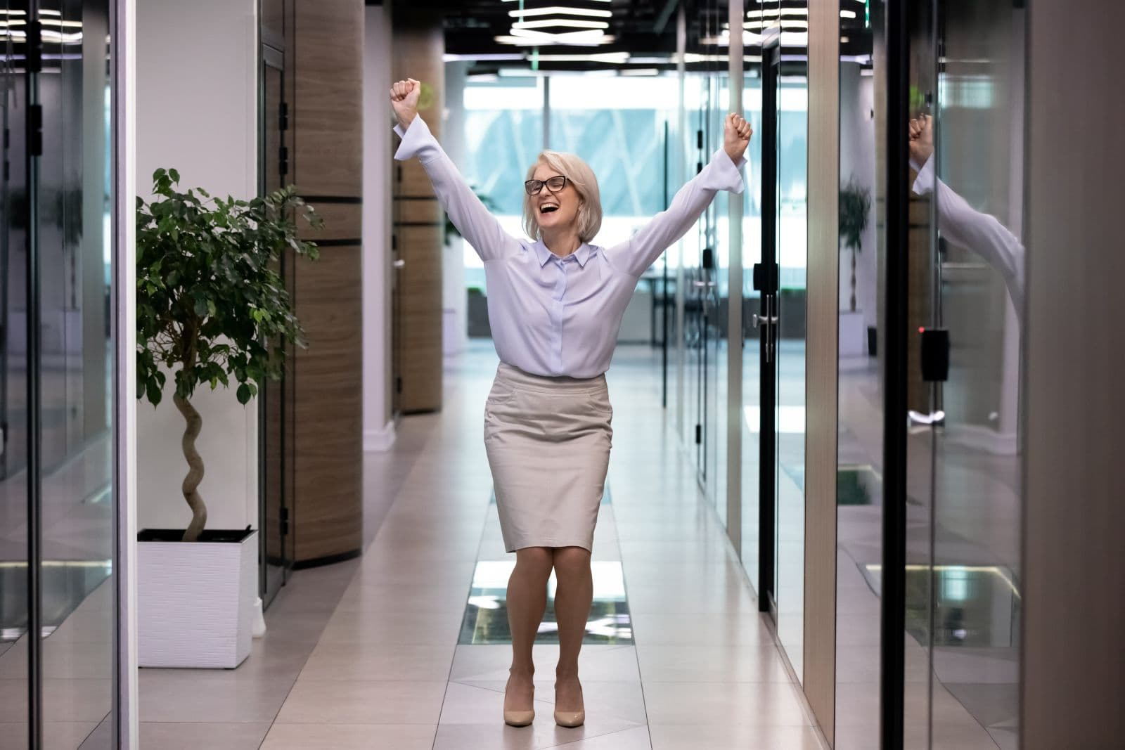 Happy,Middle-aged,Business,Lady,Celebrates,Personal,Business,Goal,Achievements,Standing